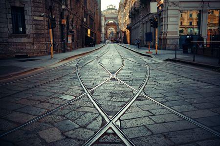 Tram track in street in Milan, Italy.