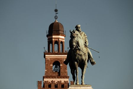 Giuseppe Garibaldi Monument and the bell tower of Sforza Castle in Milan, Italy. Stock Photo