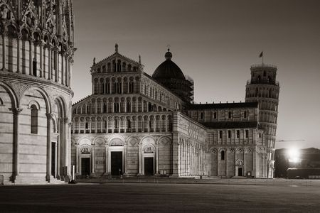 Leaning tower and cathedral at night in Pisa, Italy as the worldwide known landmark. Stock Photo