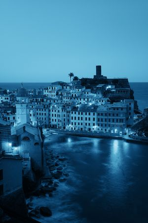 Vernazza at night with buildings on rocks over sea in Cinque Terre, Italy. 스톡 콘텐츠 - 127361094