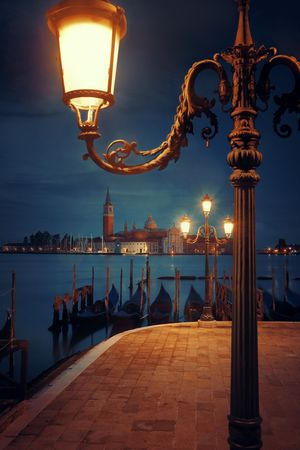 Venice at night with street lamp and San Giorgio Maggiore church in Italy.