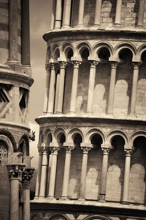 Leaning tower closeup view with cathedral in Pisa, Italy as the worldwide known landmark.