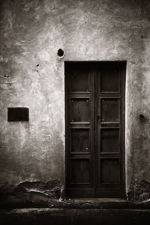 Vintage door and wall in Florence in Italy