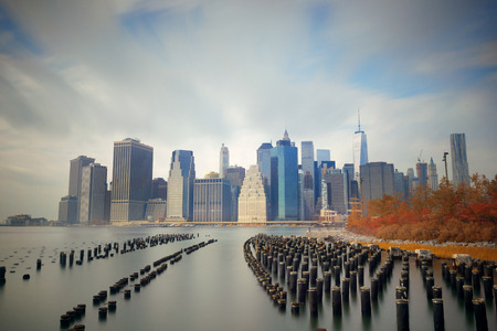 Downtown Manhattan skyline with pier wood log in New York City 스톡 콘텐츠