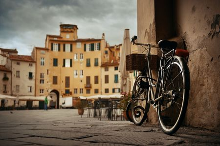 Piazza dell Anfiteatro in Lucca Italy with bike 写真素材