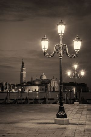 Venice at night with street lamp and San Giorgio Maggiore church in Italy. Stock fotó