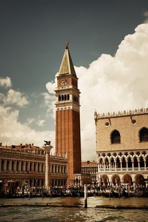 Waterfront view of Bell Tower and historical buildings at Piazza San Marco in Venice, Italy.