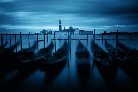 Gondola park in water and San Giorgio Maggiore island in Venice, Italy. Stok Fotoğraf