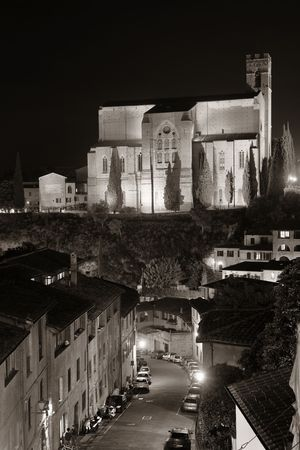 Basilica of San Domenico in old medieval town Siena at night in Italy