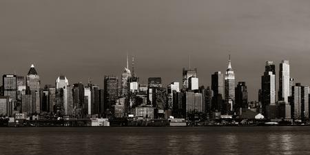 Midtown Manhattan skyline BW at dusk panorama over Hudson River