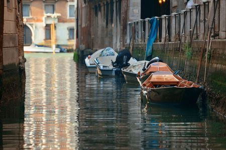 Boat park in Venice alley canal. Italy.