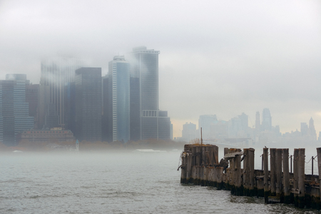 New York City downtown business district with pier in a foggy day