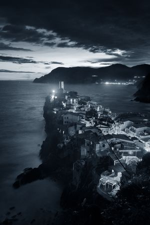 Vernazza at night with buildings on rocks over sea in Cinque Terre, Italy. Black and white. 스톡 콘텐츠