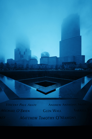 NEW YORK CITY - NOV 12: September 11 memorial in a foggy day on November 12, 2014 in Manhattan, New York City. With population of 8.4M, it is the most populous city in the United States.