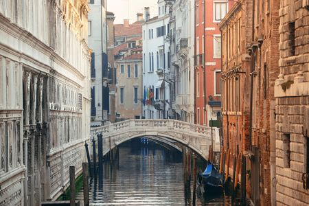 Sunny Venice canal view with historical buildings. Italy.