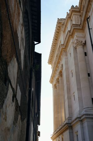 Alley with old buildings and National Monument to Victor Emmanuel II in Rome, Italy. 스톡 콘텐츠