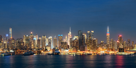 Midtown skyline over Hudson River panorama in New York City with skyscrapers at night 写真素材
