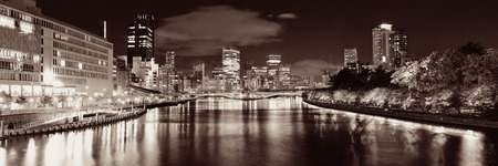 Osaka skyline over river with skyscrapers and bridge. Japan. 스톡 콘텐츠 - 127360978