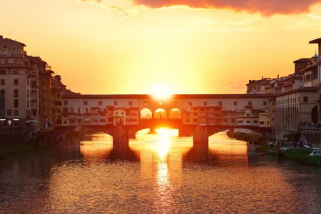 Ponte Vecchio over Arno River in Florence Italy at sunrise Stock Photo