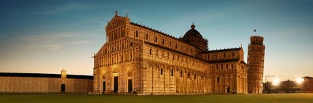 Leaning tower and cathedral at night panorama in Pisa, Italy as the worldwide known landmark.