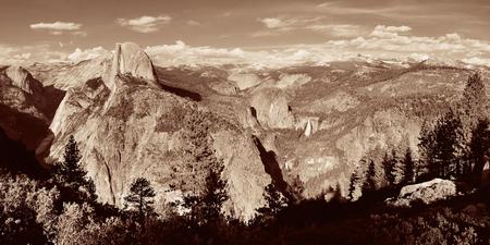 Yosemite mountain ridge black and white with waterfall. Stock Photo