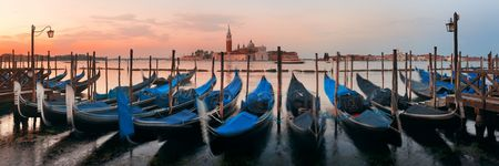 Gondola park in water and San Giorgio Maggiore island in Venice panorama view, Italy.