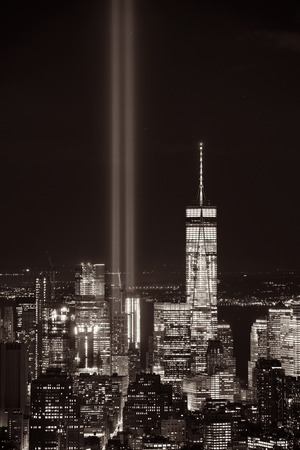 New York City downtown skyline view at night with September 11 tribute light. Stockfoto