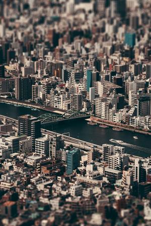 Tokyo urban rooftop view background tilt-shift effect, Japan.