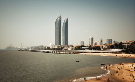 XIAMEN, CHINA – FEB 16: Shimao Twin Tower and beach on February 26, 2018 in Xiamen. Xiamen was ranked as China's 2nd-