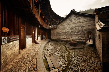 FUJIAN, CHINA – MARCH 2, 2018: Zhenfu Lou is a typical Tulou building. Tulou is the unique traditional rural dwelling of Hakka. Editorial