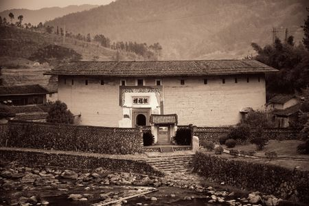 FUJIAN, CHINA – MARCH 2, 2018: Zhenfu Lou is a typical Tulou building. Tulou is the unique traditional rural dwelling of Hakka. 에디토리얼