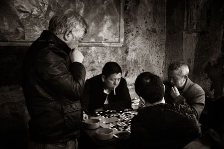 CHONGQING, CHINA – MARCH 13: Old men play cards on March 13, 2018 in Chongqing. The lifestyle of the old 80's is preserved in this Tea House as the famous tourism attracitions. 에디토리얼