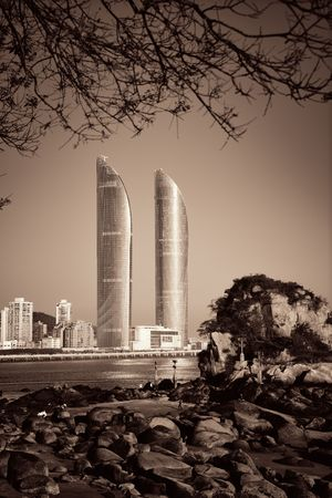 XIAMEN, CHINA – FEB 16: Shimao Twin Tower and beach on February 26, 2018 in Xiamen. Xiamen was ranked as Chinas 2nd-most suitable city for living