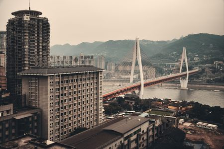 CHONGQING, CHINA – MARCH 13: Dongshuimen Bridge with urban buildings on March 13, 2018 in Chongqing. With 17M population, it is the most populous Chinese municipality.
