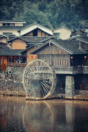FUJIAN, CHINA – MARCH 2, 2018: Yunshuiyao old town by the river with watermill in Fujian, China. Editöryel