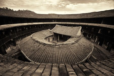 FUJIAN, CHINA – MARCH 2, 2018: Zhenfu Lou is a typical Tulou building. Tulou is the unique traditional rural dwelling of Hakka. Editöryel