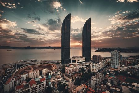 XIAMEN, CHINA – FEB 16: Shimao Twin Tower rooftop view at sunset on February 26, 2018 in Xiamen. Xiamen was ranked as Chinas 2nd-most suitable city for living Editöryel