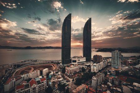 XIAMEN, CHINA – FEB 16: Shimao Twin Tower rooftop view at sunset on February 26, 2018 in Xiamen. Xiamen was ranked as China's 2nd-