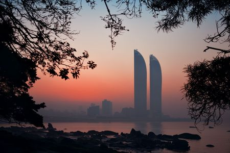 XIAMEN, CHINA – FEB 16: Shimao Twin Tower silhouette at sunrise on February 26, 2018 in Xiamen. Xiamen was ranked as Chinas 2nd-most suitable city for living