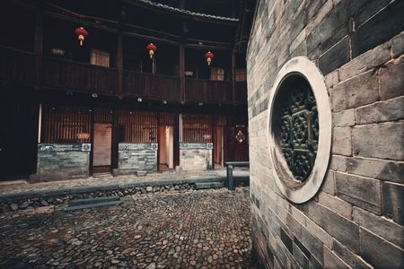 FUJIAN, CHINA – MARCH 2, 2018: A courtyard in Tulou. Tulou is the unique traditional rural dwelling of Hakka.