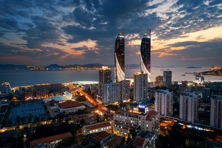 XIAMEN, CHINA – FEB 16: Dusk aerial view of city skyline on February 26, 2018 in Xiamen. Xiamen was ranked as Chinas 2nd-most suitable city for living
