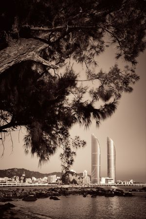 XIAMEN, CHINA – FEB 16: Shimao Twin Tower and trees on February 26, 2018 in Xiamen. Xiamen was ranked as Chinas 2nd-most suitable city for living