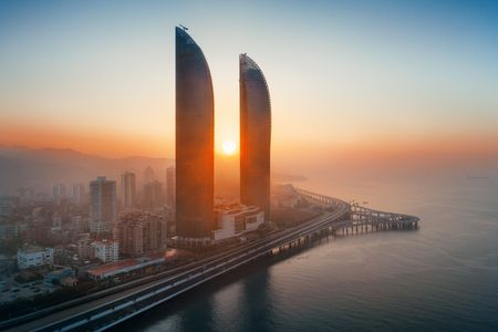 XIAMEN, CHINA – FEB 16: Aerial view of city skyline at sunrise on February 26, 2018 in Xiamen. Xiamen was ranked as Chinas 2nd-most suitable city for living