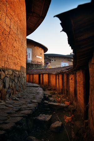 FUJIAN, CHINA – MARCH 2, 2018: Chuxi Tulou Cluster at sunset. Tulou is the unique traditional rural dwelling of Hakka. 新闻类图片