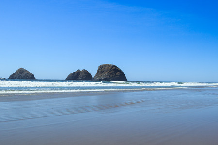 capes: Haystacks at Oceanside Beach, Oregon Stock Photo