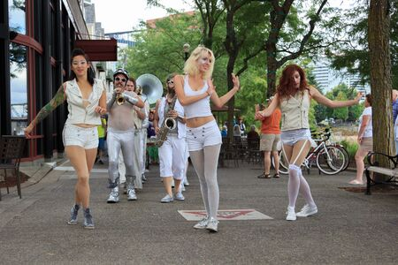 willamette: Portland, Oregon, USA - July 26, 2015: Marching Band LoveBomb Go-Go leading The Big Float 2015 Parade along the Willamette River waterfront