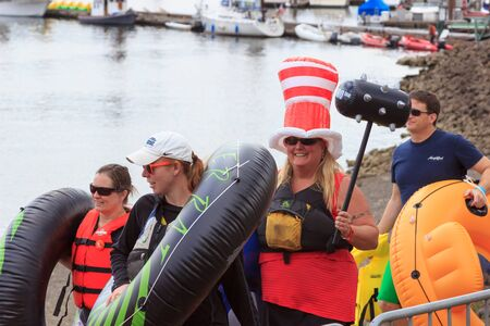 floaters: Portland, Oregon, USA - July 26, 2015: The Big Float attendees parade down the waterfront to begin floating down the Willamette River Editorial
