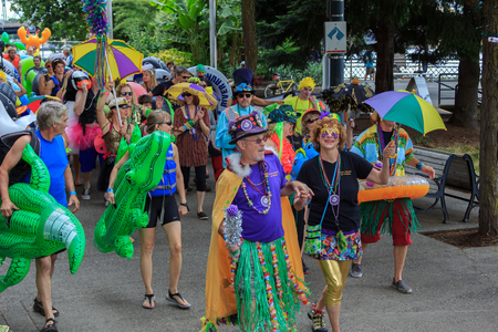 floaters: Portland, Oregon, USA - July 26, 2015: Portland, Oregon, USA - July 26, 2015: The Big Float attendees parade down the waterfront to begin floating down the Willamette River