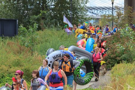 floaters: Portland, Oregon, USA - July 26, 2015: Floaters gather in line and the procession leads to the water to float back down the Willamette River Editorial