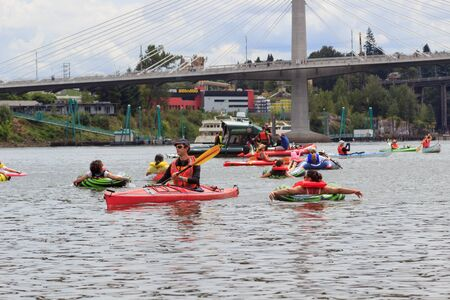 floaters: Portland, Oregon, USA - July 26, 2015: Floaters enjoy the coast down the Willamette RIver during The Big Float 2015